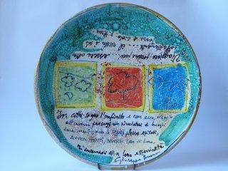 """( CODICE ARTICOLO: LM/05) """"In città sogno..."""" - piatto murale da 35 cm dipinto a mano.Tecnica:maiolica"""