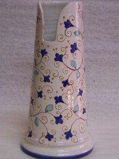 (CODICE ARTICOLO: AB/12)Portascopino decorato a mano con motivo floreale.Tecnica: maiolica
